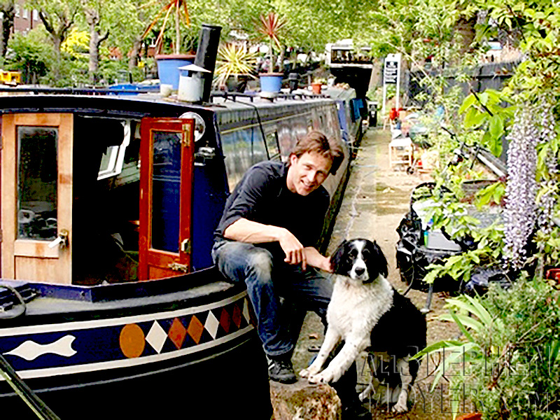 Stephen Moyer outside his houseboat with his dog Splash in London.
